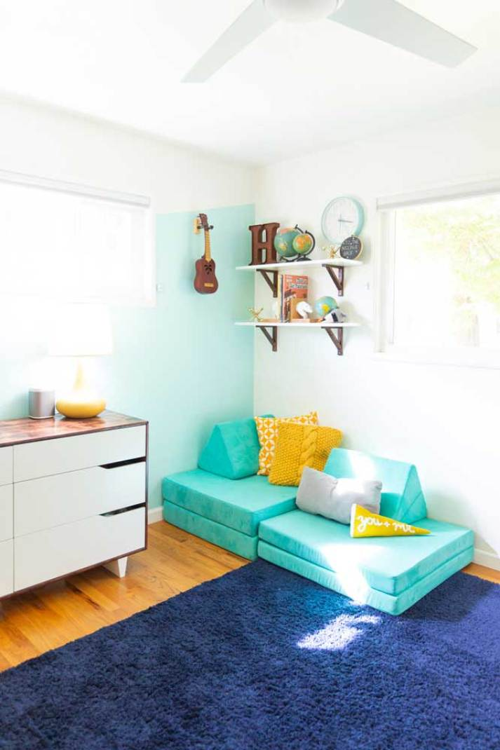 mid century colorful kids bedroom with cell shades fully raised in window