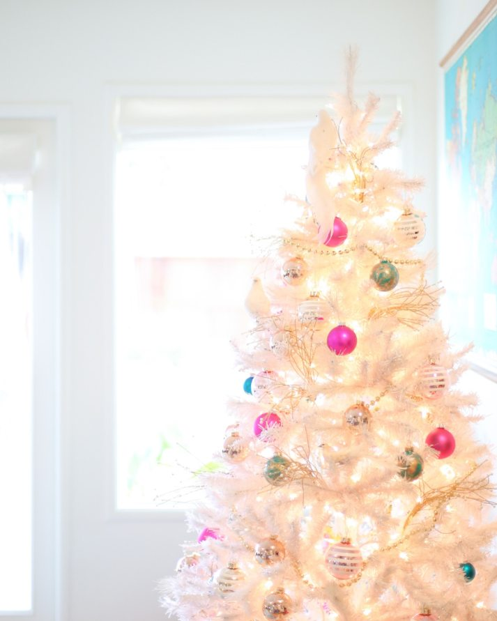 white christmas tree with pink ornaments