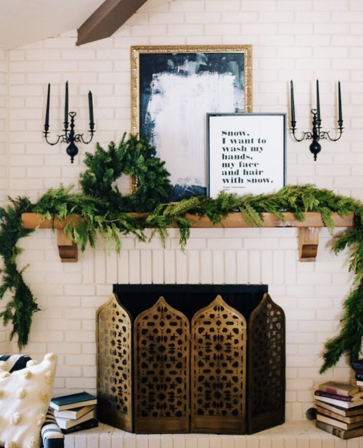 eclectic fireplace with natural garland and wreath for christmas