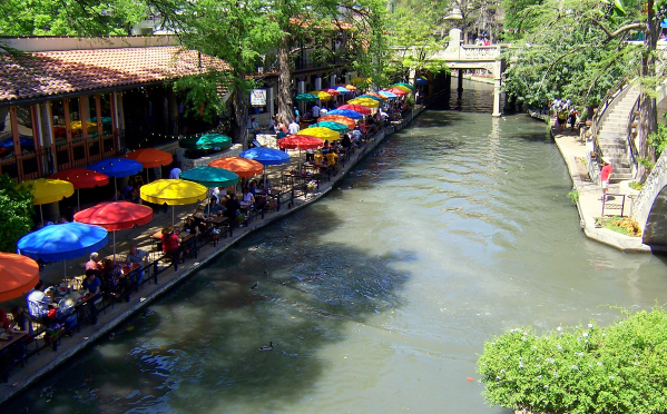 A photograph of the San Antonio Riverwalk. Just like me, the people in this photo have not fallen in the river.