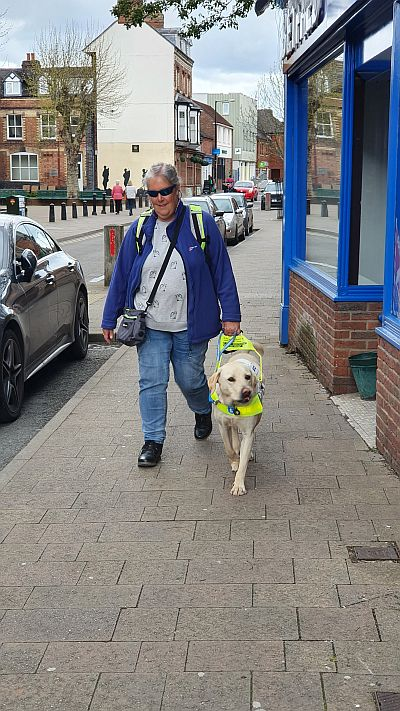 Tracey and Loki walking together down Market Drayton main shopping street.