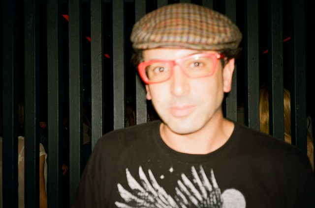 1024px-Darshan_Jesrani_with_red_glasses