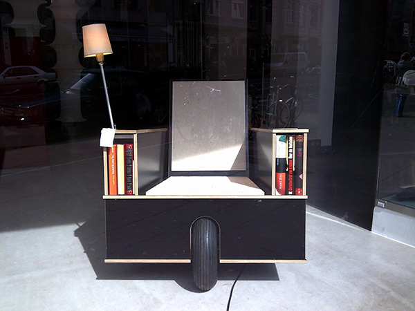 mobile block chair with lamp and books, found in Cologne