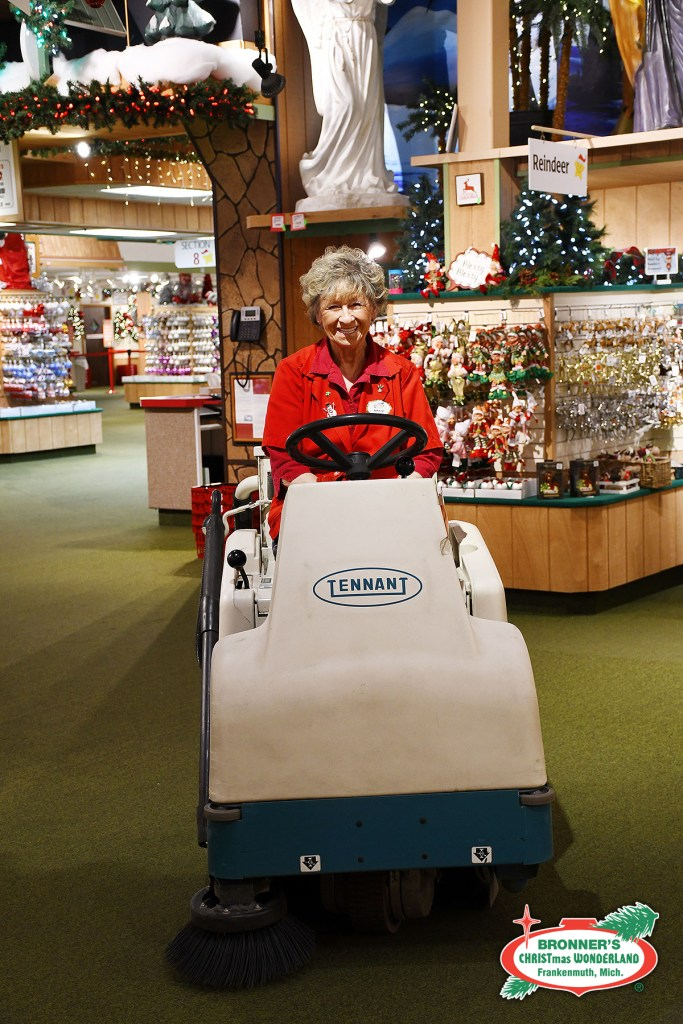 Mary from Bronner's sparkle team vacuums the store