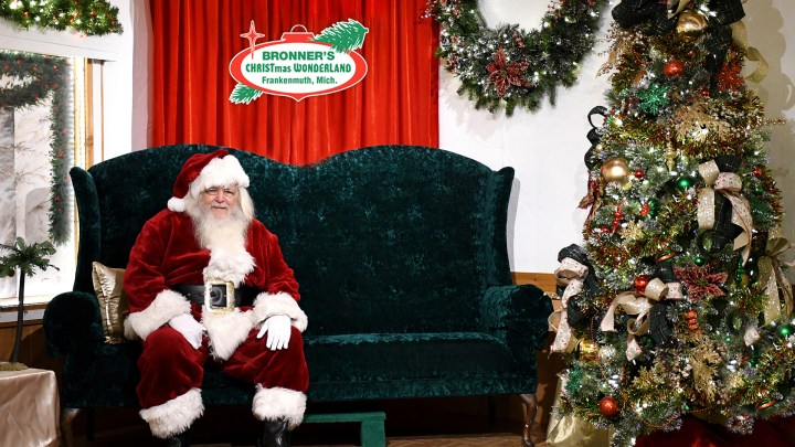 Santa Claus sitting on a Christmas couch