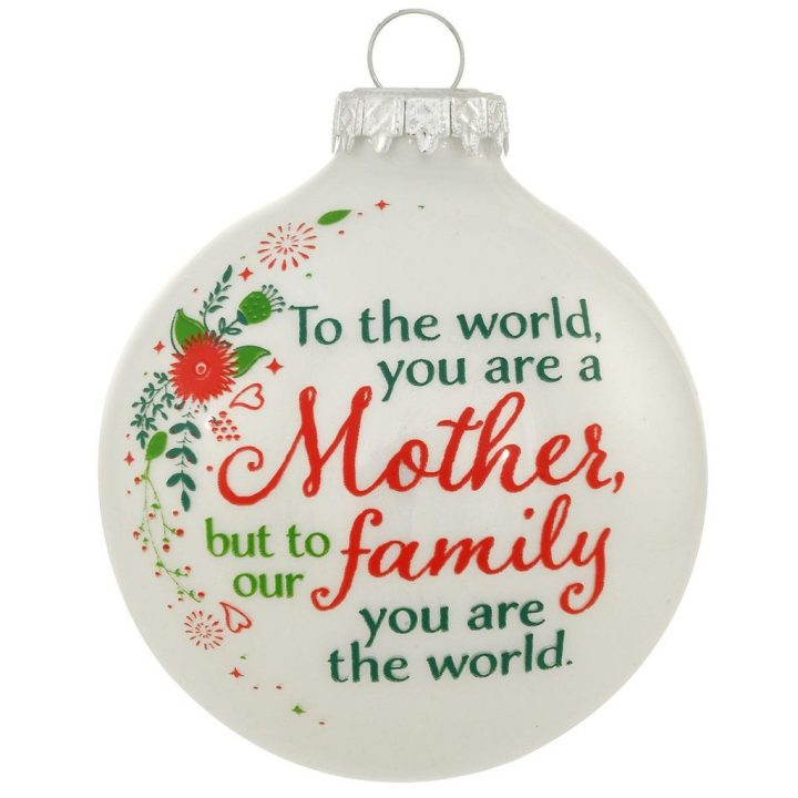 """Wish your mother a Happy Mother's Day with this round white glass ornament with a red and green swirl of flowers and the sentiment, """"To the world, you are a Mother, but to our family you are the world."""""""