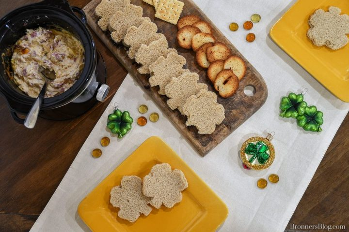 Irish ornaments add a festive touch to the table plated with warm reuben spread and bread, crackers and chips.