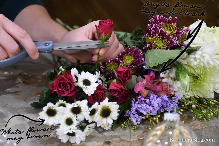 Cutting rose bud from bouquet