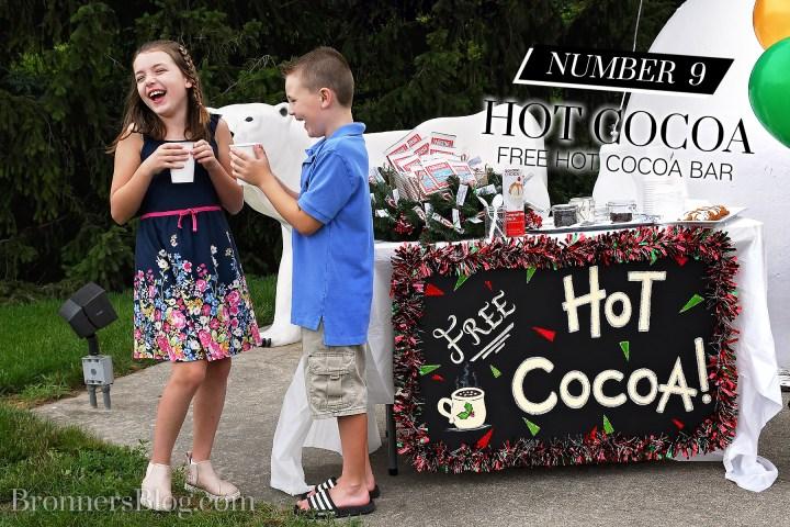 Kids enjoying free hot cocoa booth