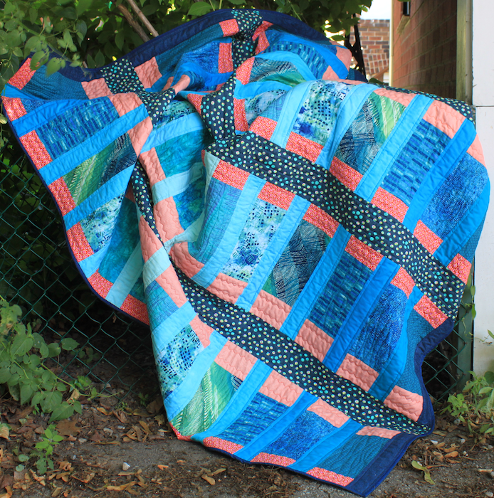 Blue Bayou Quilt draped