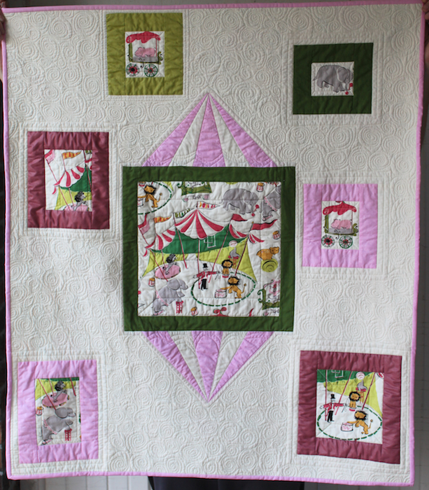 Modern circus baby quilt by Doris Lovadina-Lee