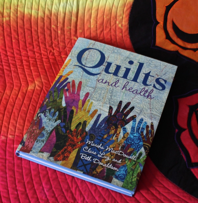 Quilts and Health book by Marsha MacDowell, Clare Lug and Beth Donaldson with radiant light quilt by doris lovadina-lee toronto quilter