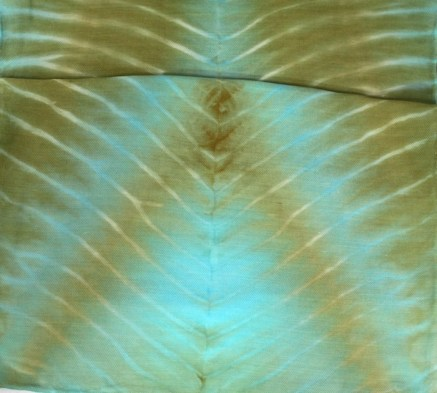 detail of arashi shibori wool and silk blend scard dyed with olive green and turquoise fibre reactive dyes by doris