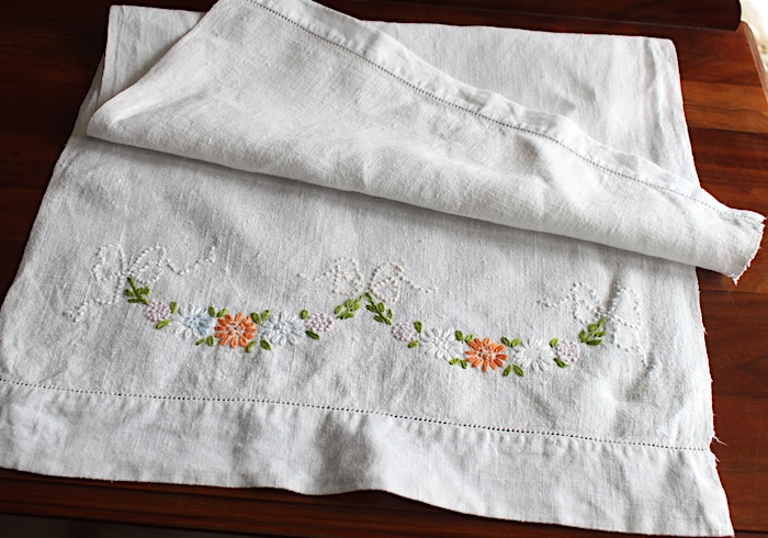 vintage textiles tea towel with garland flowers embroidered on edge Toronto doris lovadina-lee