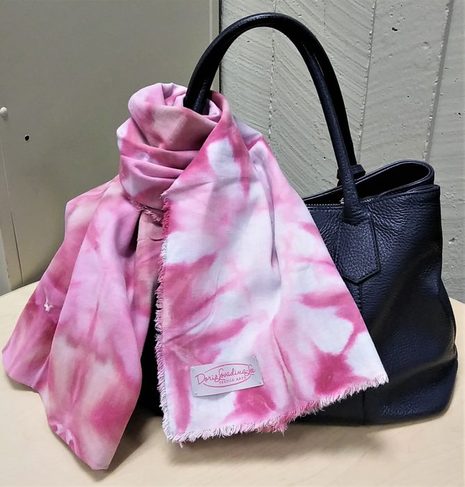 snow dyed scarf tied around a handbag with doris lovadina-lee textile arts label