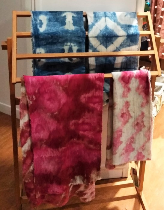Quilt stand with snow dyed shibori scarves by toronto artist Doris Lovadina-Lee