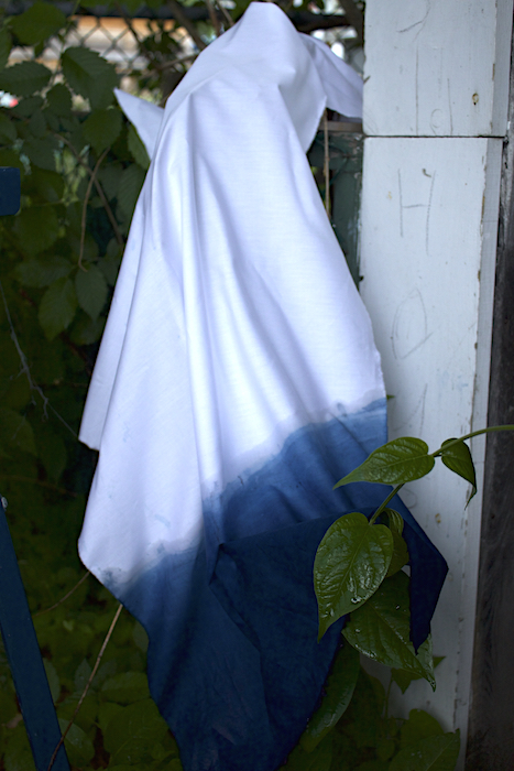 white cotton prepared for dyeing fabric dipped in indigo on fence