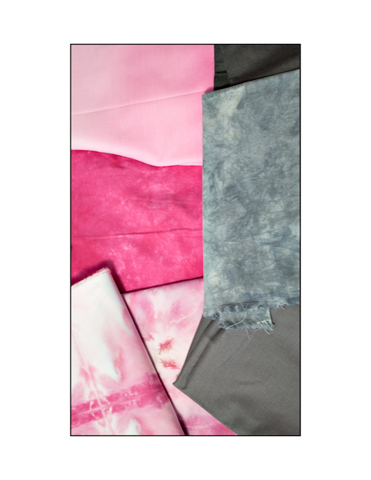 hand dyed fabrics in pink and grey for a minimal log cabin quilt