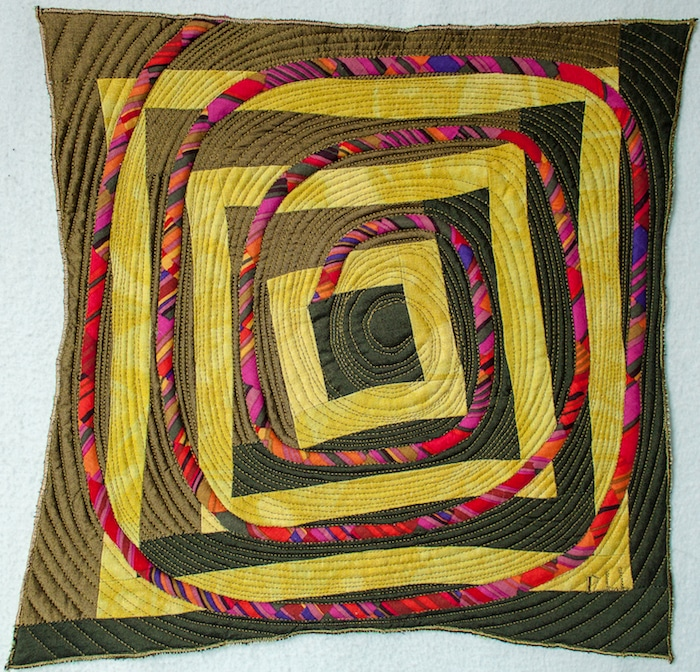 12 inch by 12 inch finished Piece/peace quilt challenge for SAQA Fergus Pod
