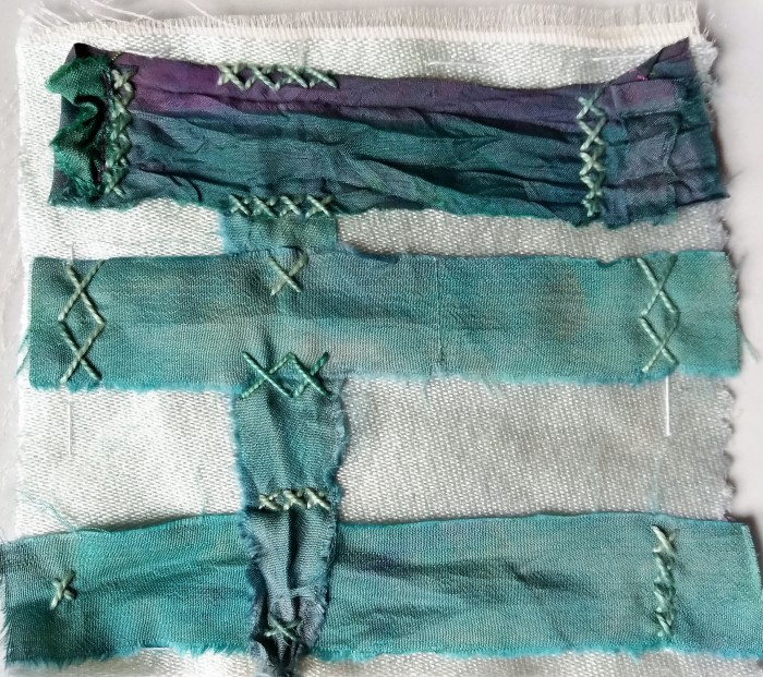 5 inch stitch meditation with white silk, repurposed sari strips, hand embroidered with cross stitches using perle cotton