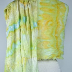 back view of Spring Meadow travel scarf snow dyed in yellow and green