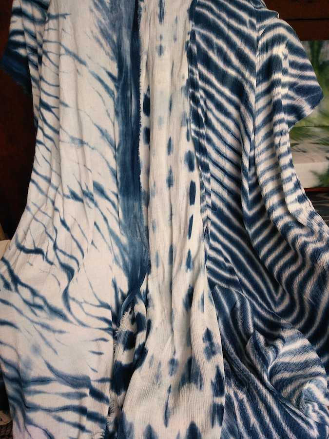 3 unique indigo dyed scarves draped over chair dyed by dorislvoadinalee