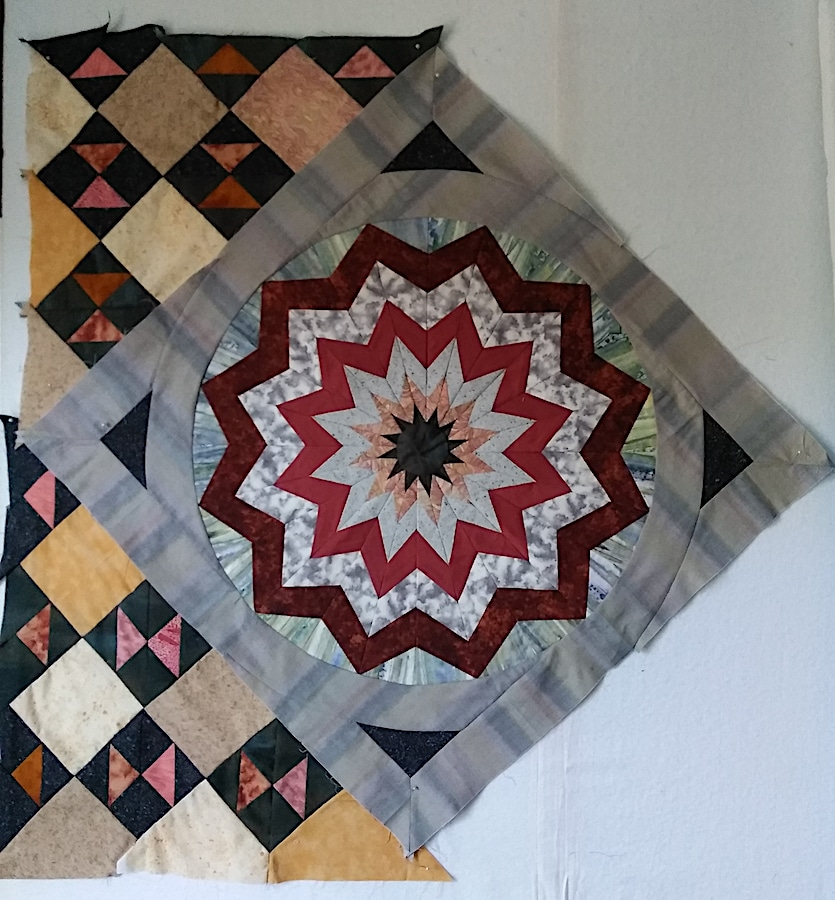 Large square with circular design bordered by 2 triangles