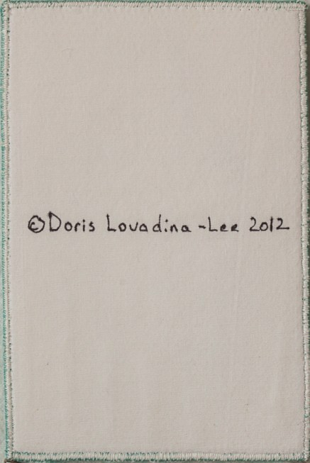 back of a 4x6 cloth postcard with copyright 2011 symbol and Doris Lovadina-Lee Designs