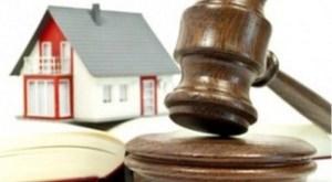 Casa venduta all'asta: chi paga il debito residuo?