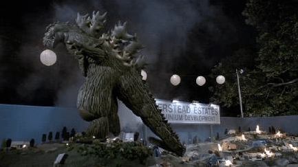 Godzilla wrecking the model in One Crazy Summer