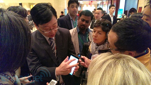 Huawei Device CMO Shao Yang shows off his Ascend Mate to journalists.