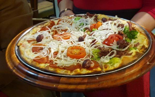 Entre as curvas do famoso Copan, descobrimos uma deliciosa pizza