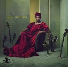 IMANY in copertina del disco Voodoo Cello con un vestito rosso