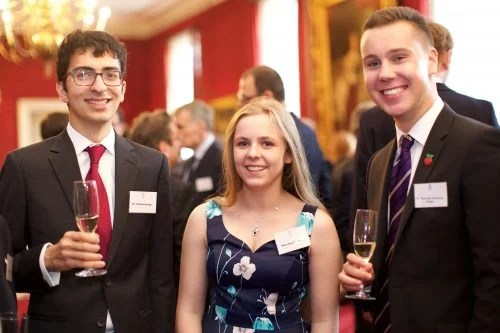 Matthew Timmons-Brown and two other young people at a reception in the Houses of Parliament