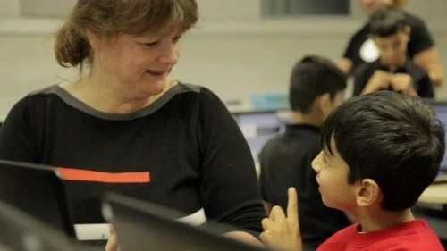 A boy learning about computing from a woman - Royal Society After the Reboot