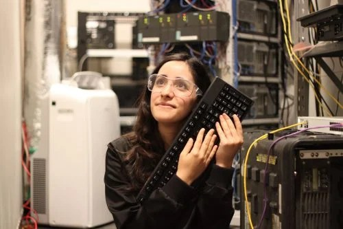 A woman wearing safety goggles hugging a keyboard Estefannie Explains it All Raspberry Pi