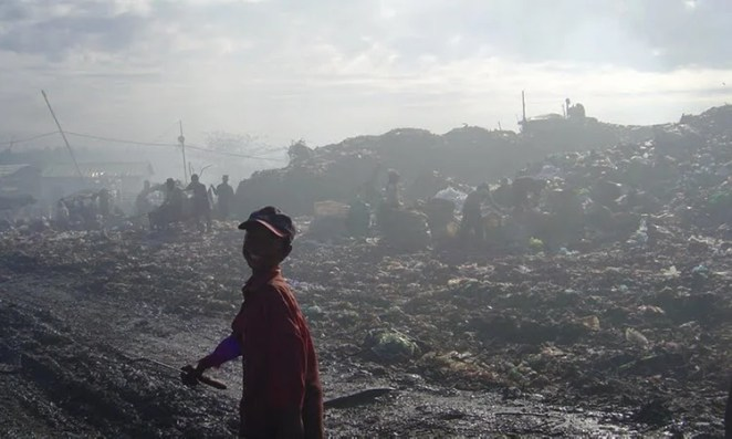 Child working as a 'waste picker' in Stung Meanchey, the largest garbage dump in Phnom Penh, Cambodia.