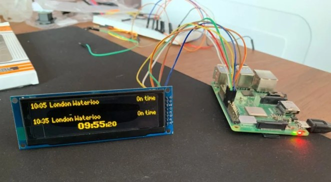 A Raspberry Pi 3B+ connected to a £25 dot-matrix display shows real-time train departure times pulled from the TransportAPI using Python 3