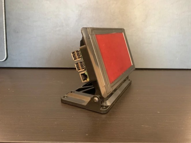 Raspberry Pi in a case with a red plastic overlay so it can be used at night