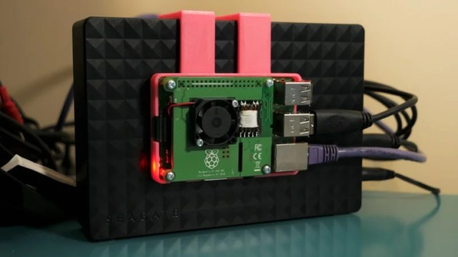 A familiar sight to many Raspberry Pi owners – a Raspberry Pi-powered media server. We like the 3D-printed mounting to cut down on the footprint