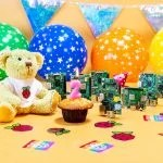 A celebratory photo of a birthday party for Raspberry Pi computers