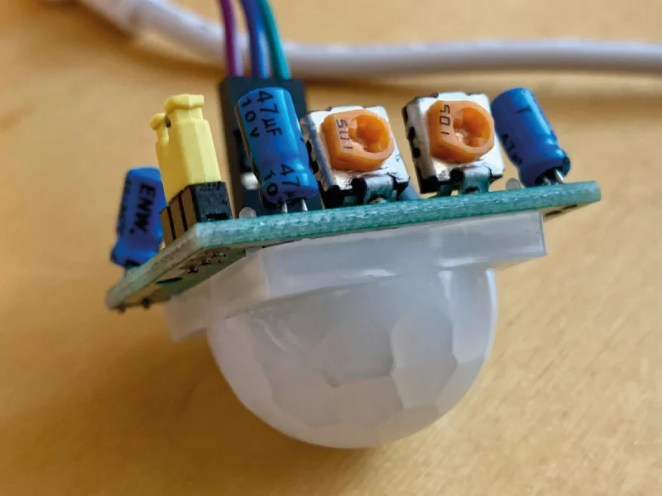 Figure 1. The PIR sensor's potentiometers (orange). Adjust carefully with a small screwdriver, as they can be fragile