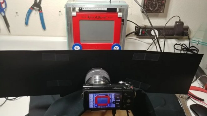 For the creation of stop-motion videos, the camera sits behind black fabric to prevent reflections, and each image is drawn 1to 2mm apart for smooth footage