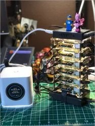 Lego batman and his lego friend atop a cluster of Raspberry Pi