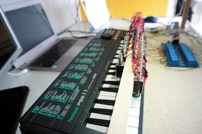 Raspberry Camera Module is used to read sheet music, its images being analysed using optical musical recognition