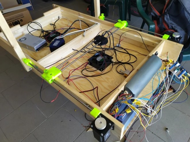 The inner workings of the table revealing the two fans and extensive wiring required