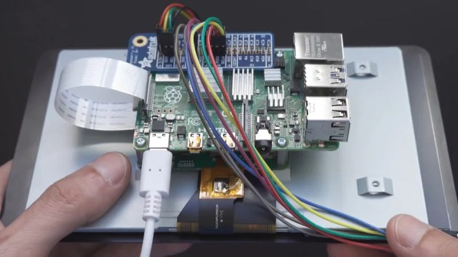 A Raspberry Pi 3 sits in the housing andconnects to a LiPo battery that also powers the LEDs and motors