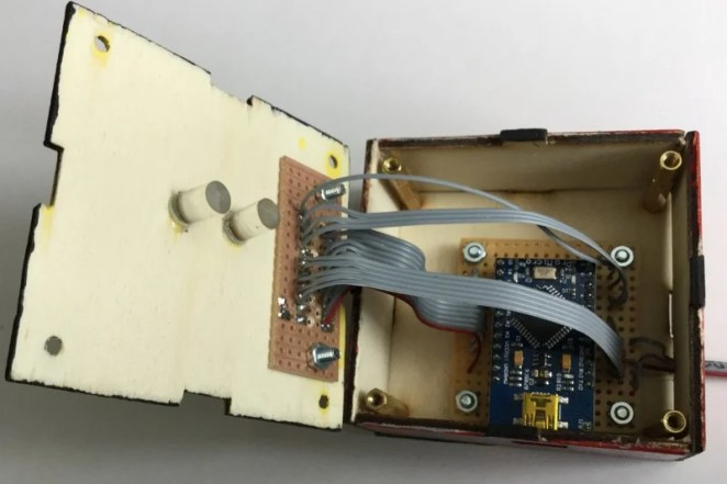 Photograph of the Arduino board and box