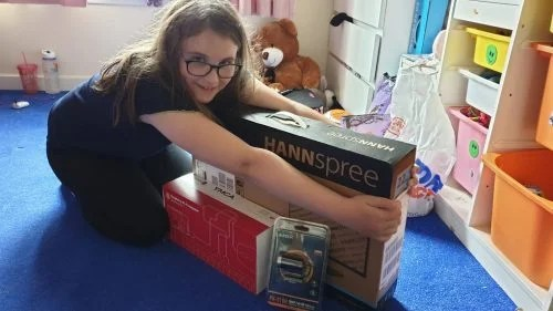 A young person receives a Raspberry Pi kit to learn at home