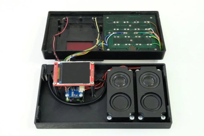 The inner workings include a Raspberry Pi Zero with WM8960 Audio HAT, speakers, and 176×220 LCD